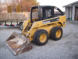 John Deere 320 Skid Steer photo