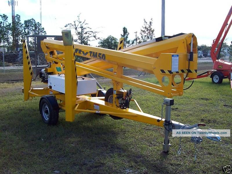 Nifty Tm50 56 ' Towable Lift,  28 ' Outreach,  Battery Powered For Indoor Use,  New Lifts photo