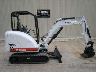 2005 Bobcat 328,  27.  5hp,  6146lbs,  Open Cab,  New Paint,  Good Tracks,  1910 Hrs photo