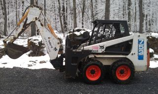Bobcat 753 skid steer loader with 709 backhoe attachment photo