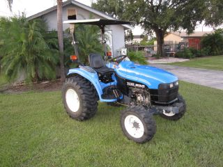 New Holland Tc 33 Diesel Compact Tractor 4 Wheel Drive R3 Tires 558 Hrs photo