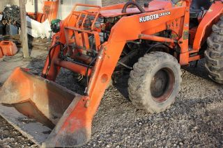 Kubota 4x4 Tractor With Loader,  Blown Motor. photo