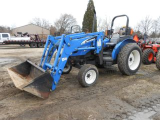 New Holland Tn60a Tractor Loader,  Good Shape photo