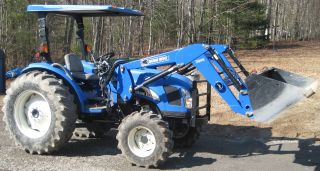 New Holland Tc48da Tractor 4wd 516 Hours photo