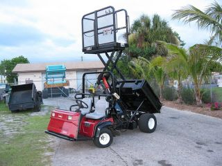 Toro Workman 3100 Dump Body Scissor Lift Man Lift photo