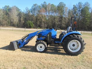 2008 New Holland T2320 W/270l Quick Attach Loader; 4wd.  81 Hours photo