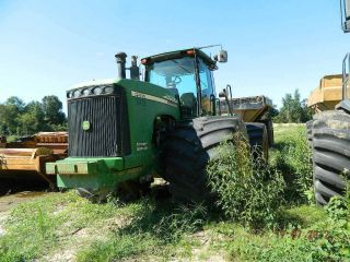 Deere Scraper Special 9520 Singles 4400 Hours photo