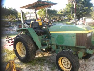 John Deere 870 Farm Tractor With Bush Hog photo