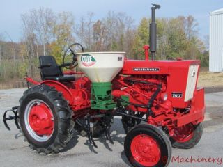 International Farmall 140 Tractor W/cultivators & Side Dresser photo