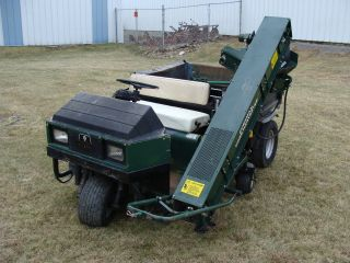 Cushman Truckster W/ Core Harvester photo