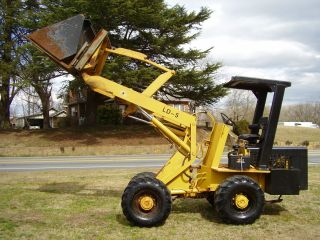 Wrangler Ld - 5 Articulating Wheel Loader 4x4 With Bucket & Forks photo