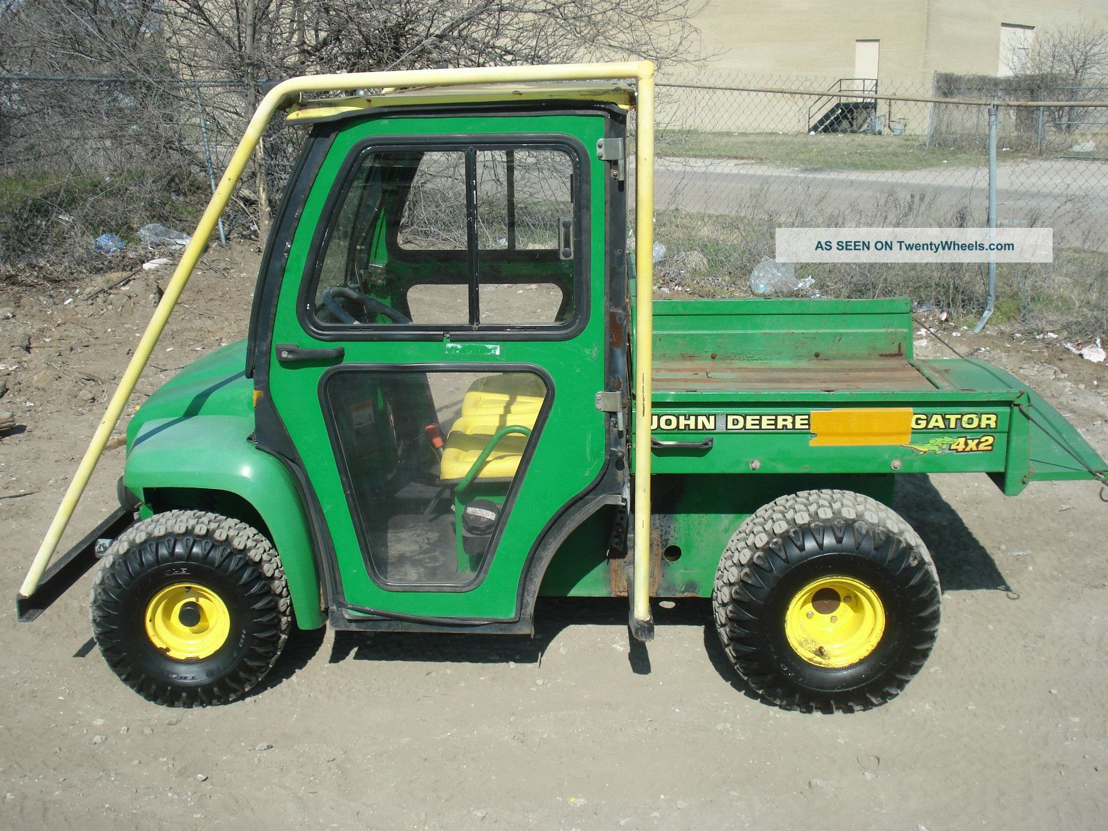 John Deere Gator 4x2 - Hard Enclosed Cab - Stay Warm And Dry Utility Vehicles photo
