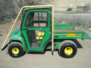 John Deere Gator 4x2 - Hard Enclosed Cab - Stay Warm And Dry photo