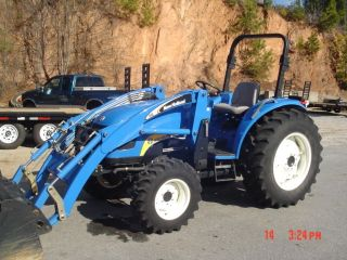Holland 60hp 4x4 Loader photo