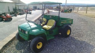 2000 John Deere 4x2 Gator Utv W/ Canopy.  Kawasaki Engine. . photo