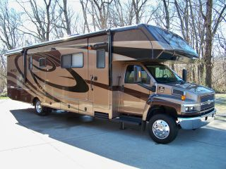 Popular A Class C Motorhome Is Typically An RV With The Living Accommodations Built On A Cutaway Van Chassis A Fullsize Bed In The Cabover Section Allows For Ample Seating, Galley And Bathroom Facilities In The RV Coach Also Called A &quotmini