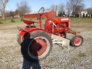 Mccormick Farmall Cub Tractor With Blade And Plow Attachments,  Wheel Weights photo