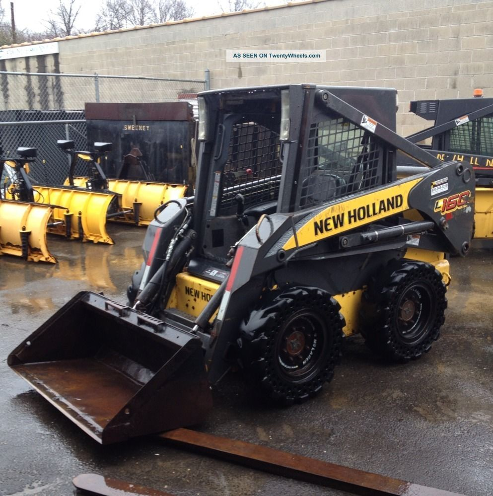 Holland L160 Skid Steer - Solid Tires - Hyd.  Mounting Plate - Aux.  Hyd.  - Gp Bucket Skid Steer Loaders photo