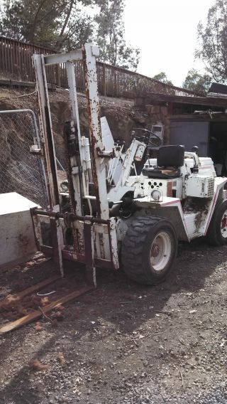 Roughterrain Forklift Champ Cb 50 3000 Lift,  6 Foot Heght 4 Cyl.  Diesel 3 Spd. photo