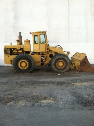 International H 90 E Wheeloader,  Caterpillar,  Komatsu,  Case Jd photo