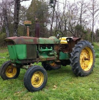 John Deere 4010 Deisal Farm Tractor.  Tractor Runs And Drives Great photo
