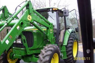 2006 John Deere 6415 Tractor photo