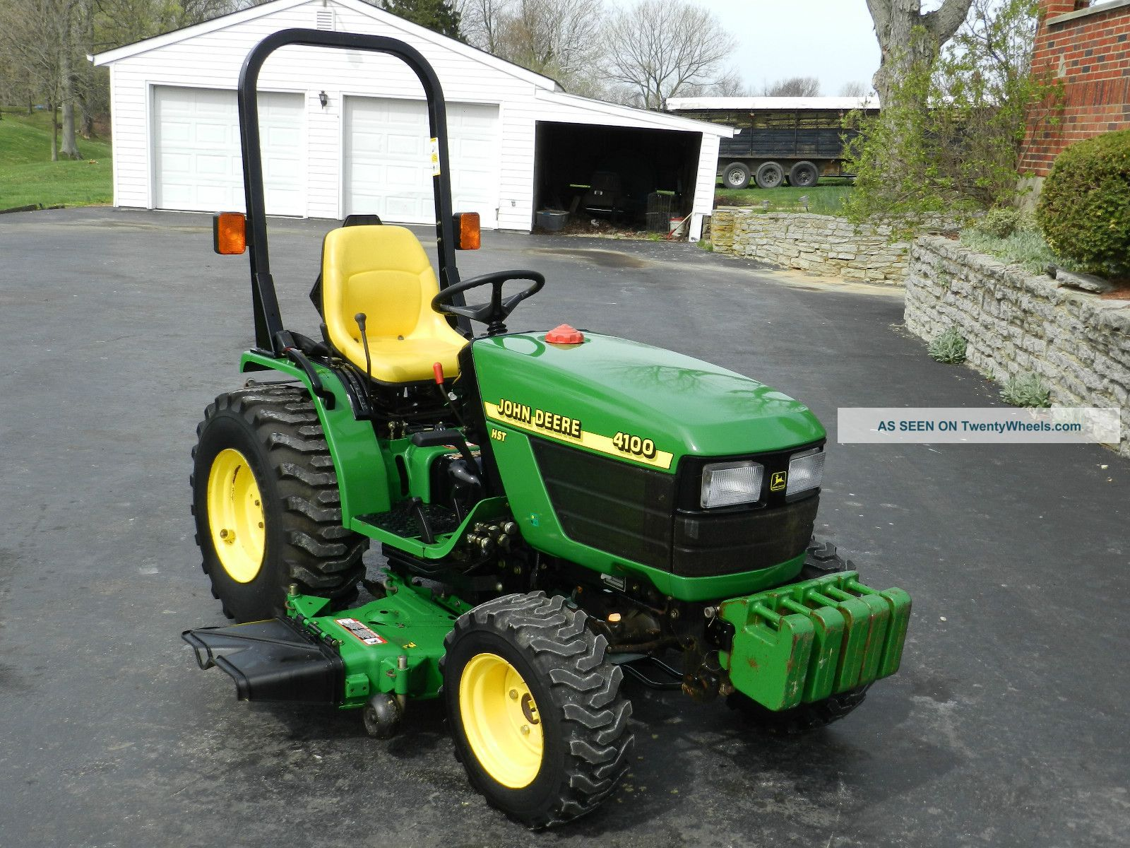 http://twentywheels.com/imgs/a/a/g/x/r/john_deere_4100_compact_tractor__54_in_belly_mower_____4x4___450_hrs_5_lgw.jpg