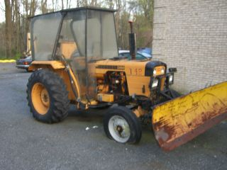 Case Tractor With Front Snow Blade photo