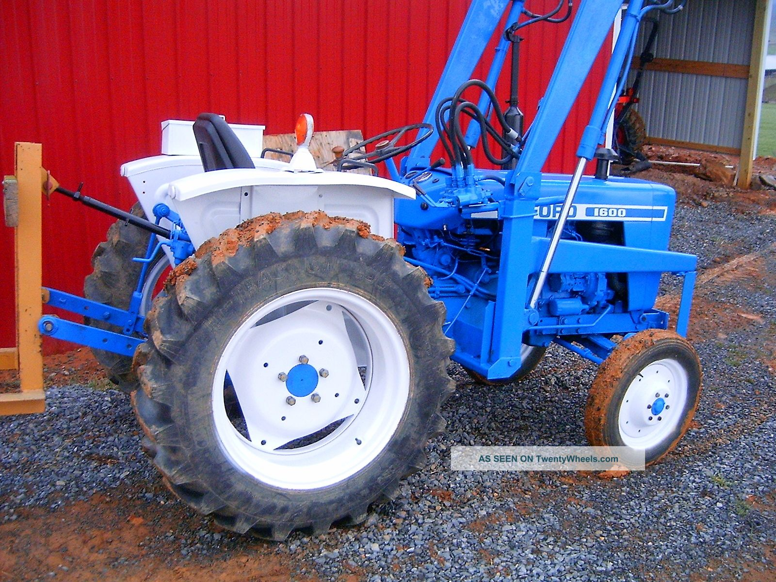 Ford 1600 Compact Tractor With Loader And Bushhog Low Reserve Tractors photo