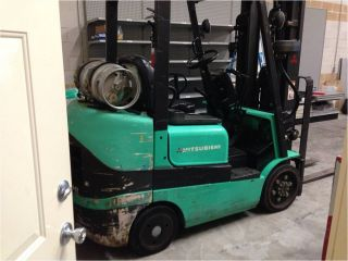 Forklift,  Pallet Jack,  And Riser photo