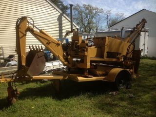 Trencher,  Backhoe,  Backfill Blade,  Steel Tracks photo