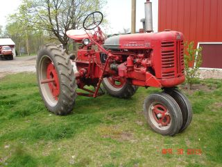 1955 Mccormick Farmall 200 Tractor With Attachments photo