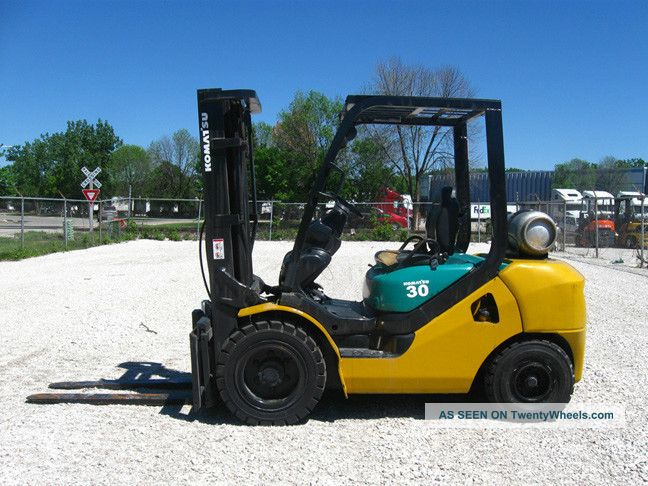 Komatsu 6000 Lb Capacity Forklift Lift Truck Pneumatic Tire Triple Stage Lp Gas Forklifts photo
