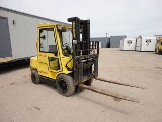2003 Hyster 6000lb.  Fork Lift Model (h60xm) Diesel Enclosed Cab 4812hrs,  1899a photo
