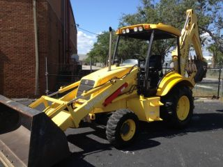 2005 Holland Lb75b Backhoe,  4x4 Only 559 Hrs. photo