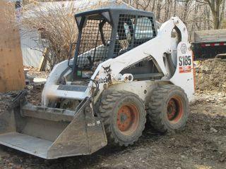 Bobcat Skidsteer S185,  Backhoe And Trailer photo