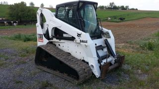 2004 Bobcat T300 Track Skid Steer Loader Diesel Tractor Construction Machine. . . photo