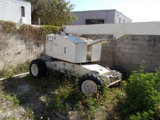 30 Foot 4 Wheel Drive Man Lift,  Needs Cylinder Work. photo