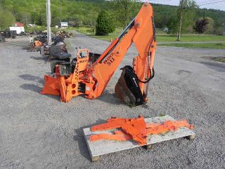 Bradco 511 Backhoe Attachment For Kubota M Series Tractor With Hydraulic Thumb photo