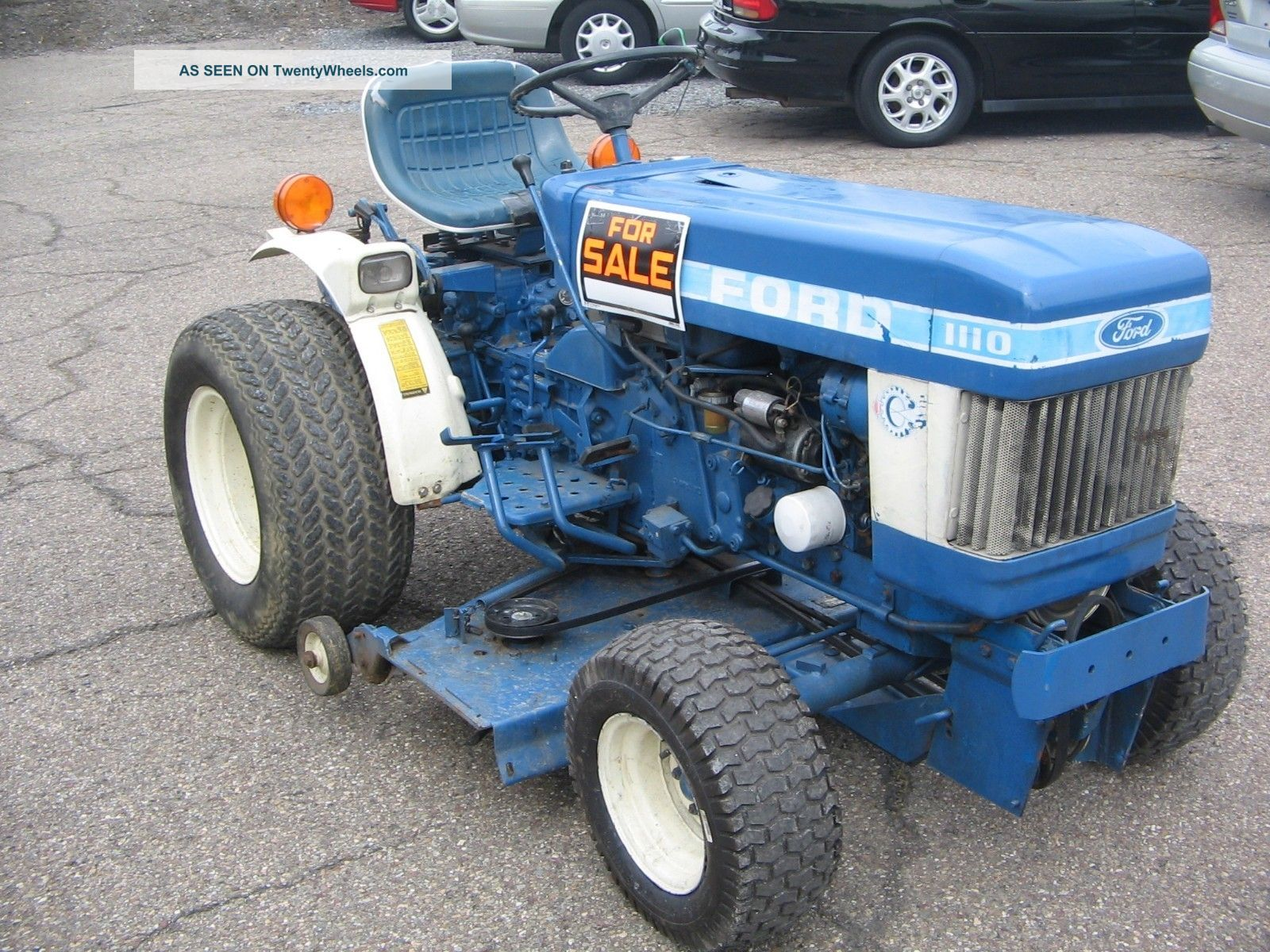9132 Ford 1110 diesel tractor with mower deck 3 point pto on belly dump semi trailers