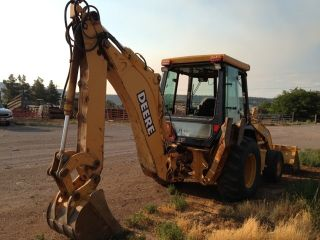 John Deere 310e Backhoe 4x4 Cab Perfect With Walton Trailer photo