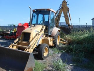 1999 Holland 575e Backhoe photo