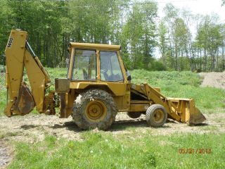 Jcb Backhoe,  Extend A Hoe With Clam Shell Bucket. photo