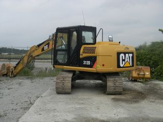 Caterpillar 312dl Excavator With Plate Compactor photo
