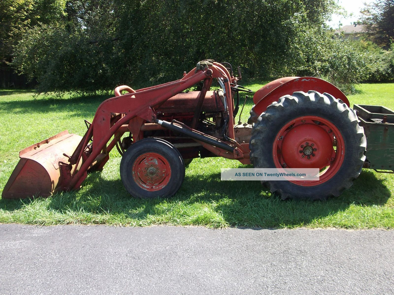 Used Lawn Tractor With Front Loader : Mccarte firewood shed plans on skid steer attachment