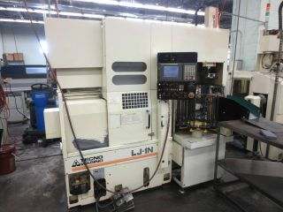 Wasino Lj - 1n Cnc Lathe With Parts Stacker/loader 6.  00