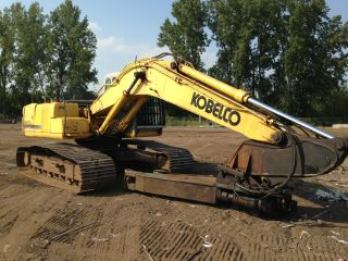 Kobelco Sk210 With Caterpillar S30 Scrap Shear photo