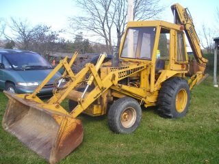 Backhoe Case 580b Extend - A - Hoe With Trailer photo