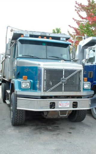 2000 Volvo Acl 64b Tri - Axel Dump Truck photo