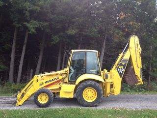 2003 Komatsu Wb - 140 Backhoe With Bucket,  Snow Bucket,  And Forks photo